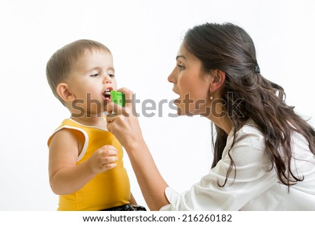 doctor giving medical spray  to kid - stock photo