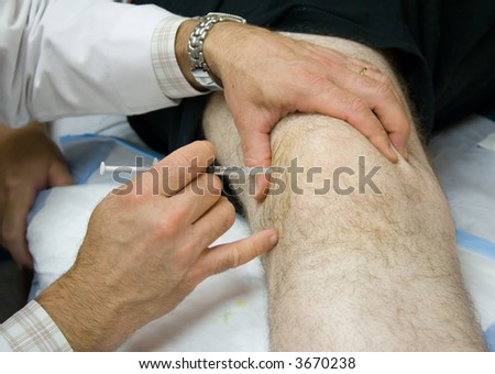 Doctor Giving Patient an Injection in His Knee - stock photo