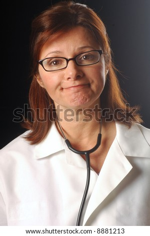 Doctor greeting the viewer with a reassuring smile - stock photo