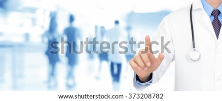 Doctor hand pointing on empty space (or virtual screen), medical panoramic background concept - stock photo