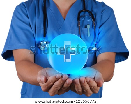 Doctor hand shows  First Aid sign on white background - stock photo
