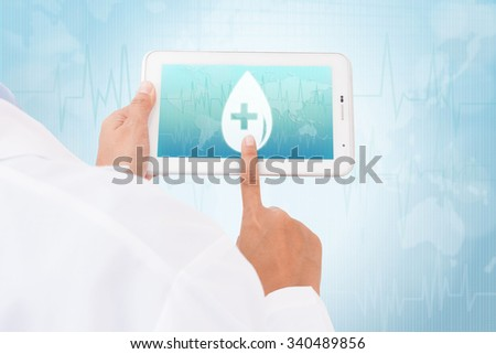 Doctor hand touch screen Donate blood Blood Drop symbol on a tablet. medical icon - stock photo
