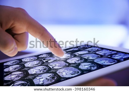Doctor hand touching modern digital tablet, close up - stock photo