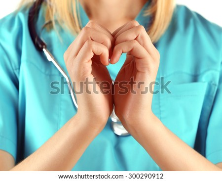 Doctor hands in shape of heart, closeup - stock photo