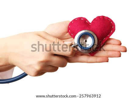 Doctor hands with heart and stethoscope isolated on white - stock photo