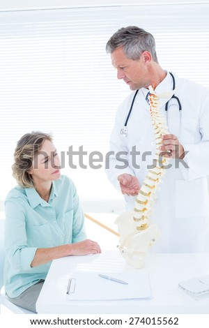 Doctor having conversation with his patient in medical office - stock photo