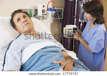 Doctor Helping Middle Aged Man - stock photo