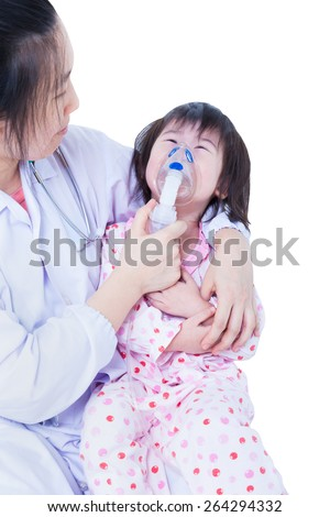 Doctor helps little asian (thai) girl taking respiratory, inhalation therapy, child was bronchitis and crying, isolated on white background
