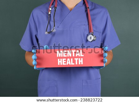 """Doctor Holding a Sign """"Mental Health"""" - stock photo"""