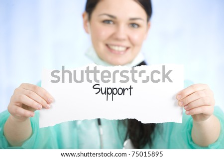 Doctor holding a sign with support word - stock photo