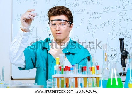 Doctor holding a syringe. Bacteriological laboratory work. Vaccinations. - stock photo