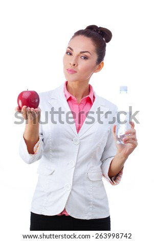 Doctor  holding apple and water bottle. Healthy lifestyle photo of Caucasian doctor isolated on white background. - stock photo