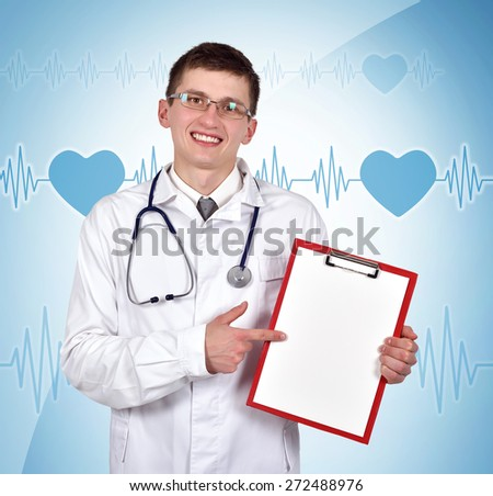 doctor holding blank clipboard on blue background - stock photo