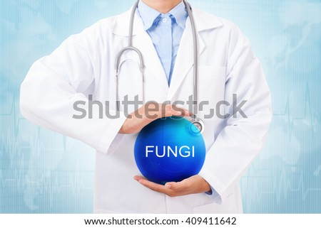 Doctor holding blue crystal ball with fungi sign on medical background. - stock photo