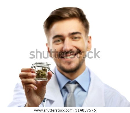 Doctor holding bottle with medical cannabis isolated on white - stock photo