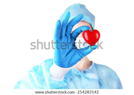 Doctor holding decorative heart on light background