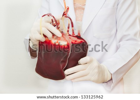 Doctor holding  fresh donor blood for transfusion - stock photo