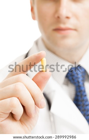 Doctor holding pills - heath care concept - stock photo