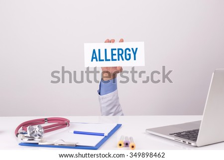 Doctor Holding Placard written ALLERGY