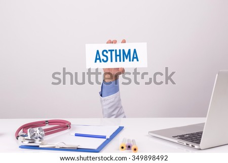 Doctor Holding Placard written ASTHMA