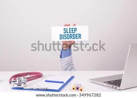 Doctor Holding Placard written SLEEP DISORDER