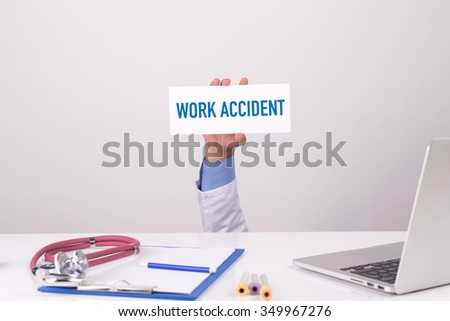 Doctor Holding Placard written WORK ACCIDENT