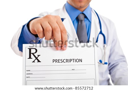 Doctor holding prescription paper - stock photo