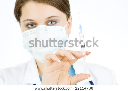 doctor holding syringe and getting ready for injection