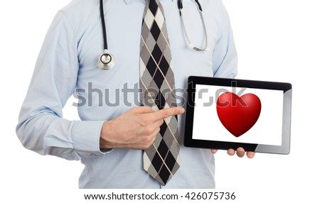 Doctor holding tablet, isolated on white - Red heart - stock photo