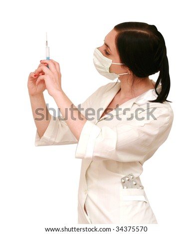 doctor in a mask with syringe - stock photo