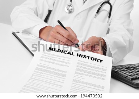 doctor in his office showing a medical history - stock photo