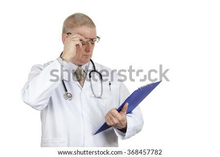 Doctor in white coat wearing a stethoscope raising his glasses to check results isolated on a pure white background
