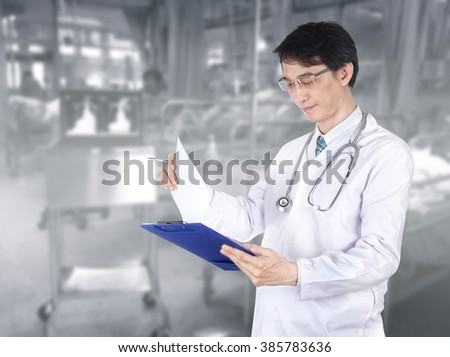 Doctor is diagnosing the illness of patients with blur background in hospital - stock photo
