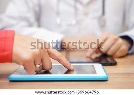doctor is sending  result of medical test to patient on tablet computer
