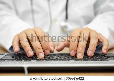 doctor is writing report into patient folder - stock photo