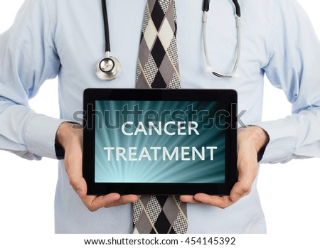 Doctor, isolated on white backgroun,  holding digital tablet - Cancer treatment - stock photo