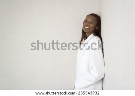 Doctor Leaning Against Wall - stock photo
