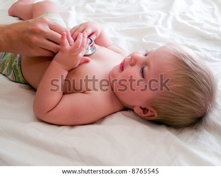 doctor listening baby with stethoscope