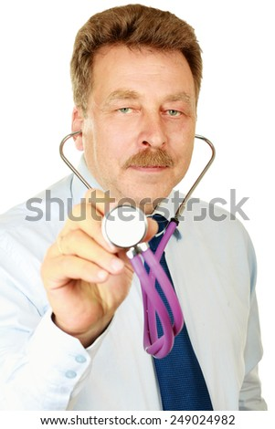 Doctor listening to a heartbeat with a stethoscope over white background - stock photo