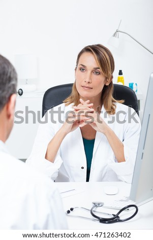 doctor listening to his patient
