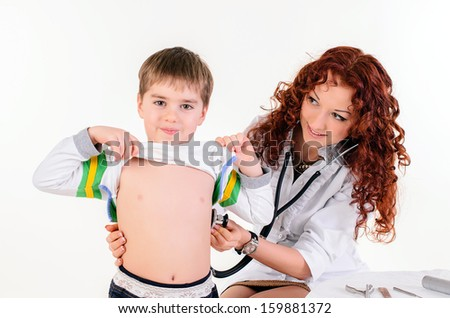 Doctor listens a stethoscope of the child on a white background - stock photo