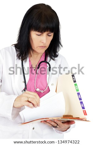 Doctor looking at medical file - stock photo