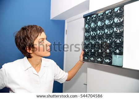 Doctor looks at computed tomography images of abdomen and cyst on kidney