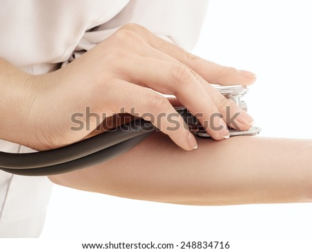 Doctor measuring  pulse, hand with stethoscope, isolated on white - stock photo
