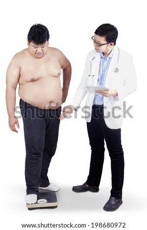 Doctor measuring the body mass of overweight man with a scale isolated on white - stock photo