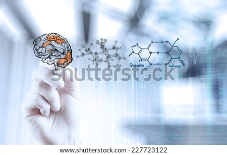 doctor neurologist hand drawing brain with computer interface as concept  - stock photo