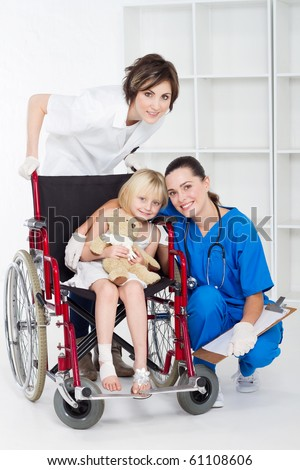doctor, nurse and little girl patient - stock photo