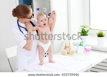 Doctor pediatrician and baby patient in clinic - stock photo