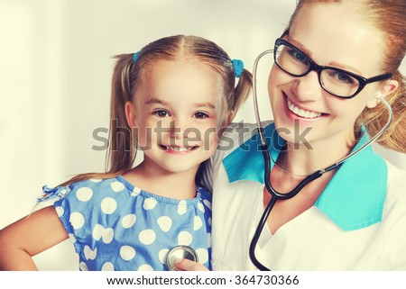 Doctor pediatrician and child patient at the reception - stock photo