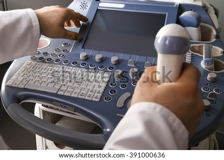 Doctor performing an ultrasound examination  - stock photo